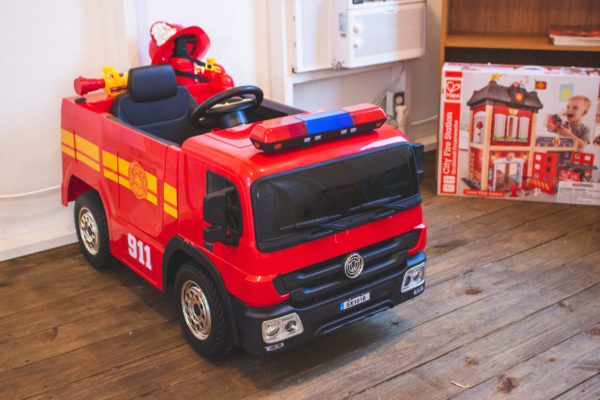 fire truck ride on toy inside playhouse made by Wish to Play