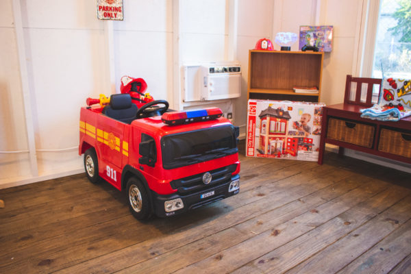 fire truck ride on toy inside playhouse made by WishTo Play